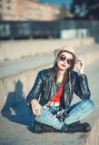 Young fashion beautiful girl in leather jacket with retro camera Stock Photography
