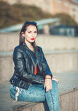 Young fashion beautiful girl in leather jacket and sunglasses Stock Images