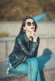 Young fashion beautiful girl in leather jacket and sunglasses Stock Photo