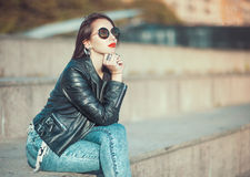 Young fashion beautiful girl in leather jacket and sunglasses Royalty Free Stock Photos