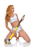 Young fashion beautiful woman with big construction yellow axe Royalty Free Stock Photo