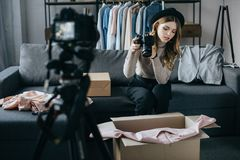 young fashion blogger recording video about dress royalty free stock photos