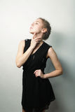 Young fashion blond woman in black dress Stock Image