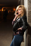Young fashion blond woman calling on mobile phone Royalty Free Stock Photo