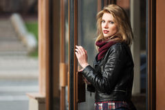 Young fashion blond woman in leather jacket Stock Image