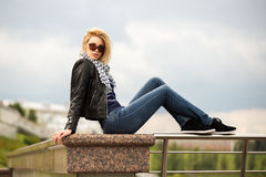 Young fashion blond woman in leather jacket outdoor Royalty Free Stock Image