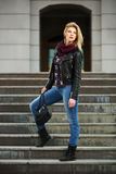 Young fashion blond woman in leather jacket Royalty Free Stock Photography