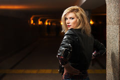 Young fashion blond woman in leather jacket Royalty Free Stock Images