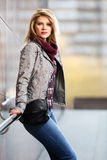 Young fashion blond woman standing at the wall Royalty Free Stock Images