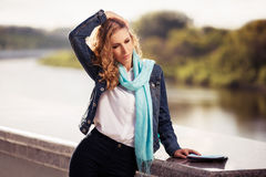Young fashion blond woman walking outdoor Stock Photos