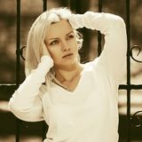 Young fashion blond woman in white pullover Royalty Free Stock Photos