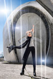 Young fashion blonde girl wearing long black scarf on the background of the futuristic building. Royalty Free Stock Images