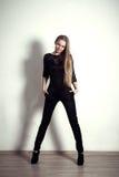 Young fashion blonde long legs girl studio posing shoot Stock Photos