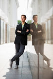 Young fashion business man standing at the wall Royalty Free Stock Image