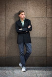 Young fashion business man standing at the wall Stock Photography