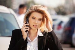 Young fashion business woman calling on the cell phone. Young fashion blond business woman calling on the cell phone Royalty Free Stock Photo