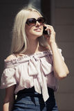 Young fashion business woman calling on cell phone Stock Images