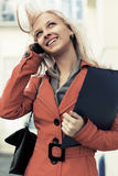 Young fashion business woman calling on cell phone. Happy young fashion business woman calling on cell phone Stock Images