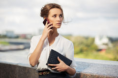 Young fashion business woman calling on mobile phone Stock Photo
