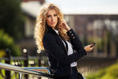 Young fashion business woman on city street Royalty Free Stock Photo