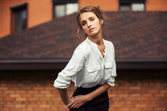 Young fashion business woman on city street Royalty Free Stock Image