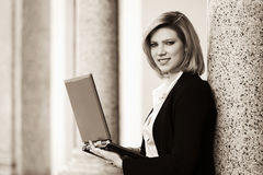 Young fashion business woman with laptop at office building Royalty Free Stock Photography
