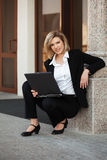 Young fashion business woman with laptop Royalty Free Stock Images