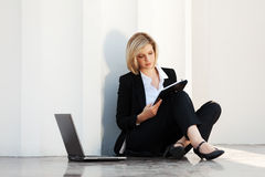 Young fashion business woman with laptop Stock Photo
