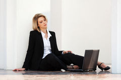 Young fashion business woman with laptop at the wa Royalty Free Stock Images