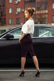 Young fashion business woman next to her car Stock Images