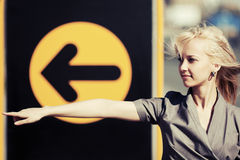 Young fashion business woman pointing a direction Stock Images