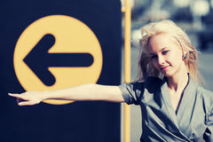 Young fashion business woman pointing a direction Royalty Free Stock Images