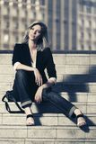 Young fashion business woman sitting on steps Royalty Free Stock Photography
