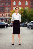 Young fashion business woman standing on car parking Royalty Free Stock Photo