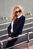 Young fashion business woman in sunglasses on the city s Stock Photography