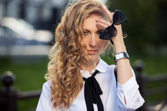 Young fashion business woman with sunglasses on city street Royalty Free Stock Photography