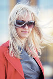 Young fashion business woman in sunglasses on the city street Stock Photography