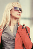 Young fashion business woman in sunglasses on city street Stock Photography