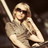 Young fashion business woman in sunglasses at office building. Young fashion blond business woman in sunglasses at office building royalty free stock photography