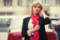 Young fashion business woman walking in city street Royalty Free Stock Photography