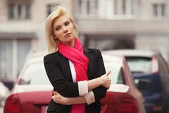 Young fashion business woman walking on city street stock photography