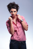 Young fashion casual woman pulling her collar Royalty Free Stock Images