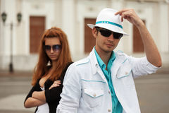Young fashion couple walking in city street royalty free stock photo
