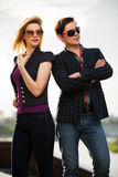 Young fashion couple in sunglasses on the city street Stock Image