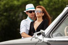 Young fashion couple at the classic car Stock Photography