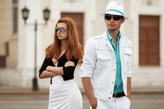 Young fashion couple in conflict on a city street Royalty Free Stock Photography