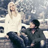 Young fashion couple in conflict in city street Stock Images
