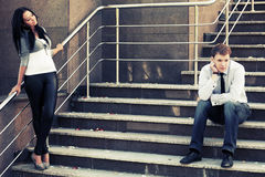 Young fashion couple in conflict on the steps Stock Image