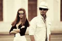 Young fashion couple in conflict walking in city street Stock Photo