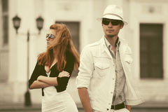 Young fashion couple in conflict walking in city street Royalty Free Stock Photography